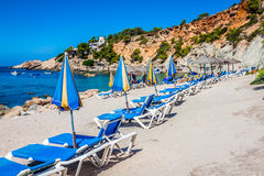 Deck chairs over the sand in a idyllic beach in Ibiza, Balearic Stock Image