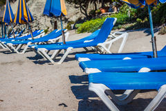 Deck chairs over the sand in a idyllic beach in Ibiza, Balearic Stock Photography