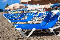 Deck chairs over the sand in a idyllic beach in Ibiza, Balearic Stock Photos