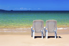 Deck chairs on paradise beach. Royalty Free Stock Images