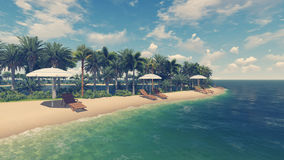 Deck chairs and parasols on empty tropical beach Royalty Free Stock Photo