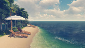 Deck chairs and parasols on tropical beach Royalty Free Stock Image