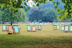 Deck chairs park sun haze Stock Images