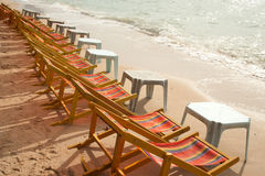 Deck chairs on Pattaya beach . Group of multicolor deck chairs on Pattaya beach in Thailand Stock Image