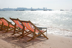 Deck chairs on Pattaya beach . Group of multicolor deck chairs on Pattaya beach in Thailand Stock Photography