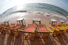 Deck chairs on Pattaya beach . Stock Image