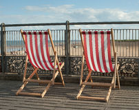 Deck Chairs on pier Royalty Free Stock Images