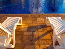 Deck chairs pool Royalty Free Stock Images