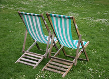 Deck chairs from rear. In park royalty free stock image