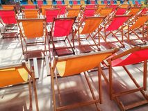 Deck chairs in a row royalty free stock image