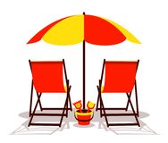 Beach umbrella and deck chairs Royalty Free Stock Image