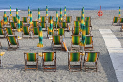 Deck chairs on the sand. Some deck chairs on the sand Stock Photo