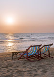 Deck chairs on the sea beach. Deck chairs on the sand on sea sunset Royalty Free Stock Image