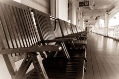 Deck chairs in sepia tones Royalty Free Stock Photos