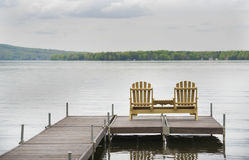Deck Chairs. Are shonw on a jetty next to a lake in the eastern townships of Quebec Royalty Free Stock Photography