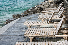 Deck chairs on the shores of Lake Geneva Royalty Free Stock Photography
