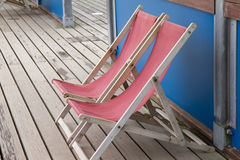Deck chairs. Standing on a pier Stock Photo