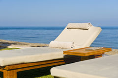 Deck chairs in the sun Royalty Free Stock Images