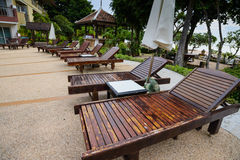 Deck chairs and Swimming pool Stock Image