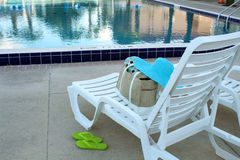 Deck chairs by a swimming pool Stock Photo