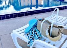 Deck chairs by a swimming pool Royalty Free Stock Photo