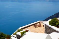 Deck chairs in Thira, Santorini, Greece Stock Photo