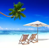 Deck Chairs on a Tropical Beach Royalty Free Stock Image