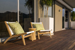 Deck Chairs. Two contemporary chairs on the deck of a luxury home Stock Image
