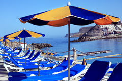 Deck chairs and umbrellas Royalty Free Stock Photo
