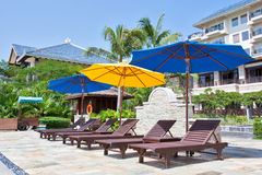 Deck chairs and umbrellas Stock Image