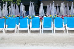 Deck chairs and umbrellas on the beach Stock Photo