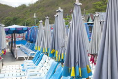 Deck chairs and umbrellas on the beach Stock Photography