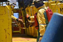 Deck crew working on deck. Ringing slinging deck crew or offshore worker working during cargo transfer stock images