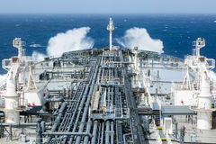 Deck of crude oil tanker with cargo pipeline. Stock Photography