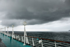Deck of a cruise-line ship with a storm coming Royalty Free Stock Image