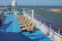 Deck of cruise liner, sun beds in lounge zone. 2018-07-06 royalty free stock image