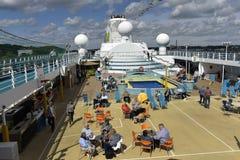 Deck of the Cruise ship AIDA cara, Harbor of Kiel, Germany. Tourists at the deck of the Cruise ship AIDA cara, Harbor of Kiel, German Stock Photo