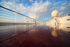 Deck of cruise ship shining by morning sun. Reflection in deck Royalty Free Stock Photo