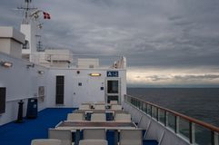 The deck of a Danish Ferry. With chairs and tables Royalty Free Stock Photo