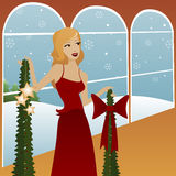 Deck the Halls. Woman holds holly garland, a red bow and luminous stars, preparing to decorate for the holidays Vector Illustration