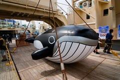 Deck of the Japanese Whaling ship Nishin Maru. Kagoshima City, Japan, April 27, 2008, An air filled replica of a whale on the deck of the whaling factory ship royalty free stock image