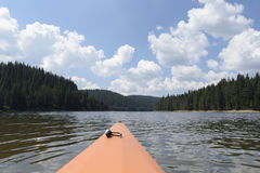 Deck of kayak and horizon of alpine lake. Selective focus Stock Image