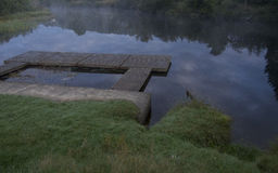 Deck on a lake at dawn Stock Photos