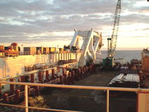 The deck lay barge. Pipes and Lifting cranes on the ship. Equipment for laying a pipeline on the seabed stock footage