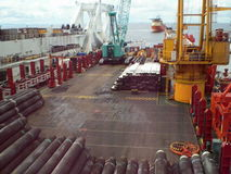 The deck lay barge. Pipes and Lifting cranes on the ship. Equipment for laying a pipeline on the seabed stock video