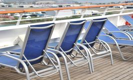 Deck lounge chairs. On a cruise ship royalty free stock image