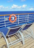 Deck lounge chairs. Lounge chairs on a cruise ship deck looking out over the ocean royalty free stock photo