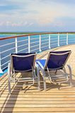 Deck lounge chairs. Lounge chairs on a cruise ship deck looking out over the ocean royalty free stock image