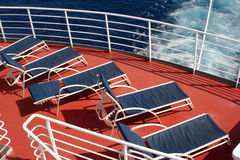 Deck Lounging. Lounge chairs on a cruise ship deck in the sun overlooking the ocean Royalty Free Stock Image
