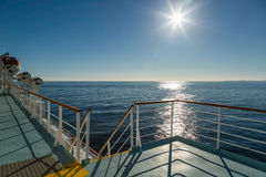 Deck of Mediterranean ferry heading towards the sun Royalty Free Stock Photo